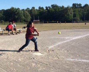 Jayme takes a swing during one of her weekly baseball games.